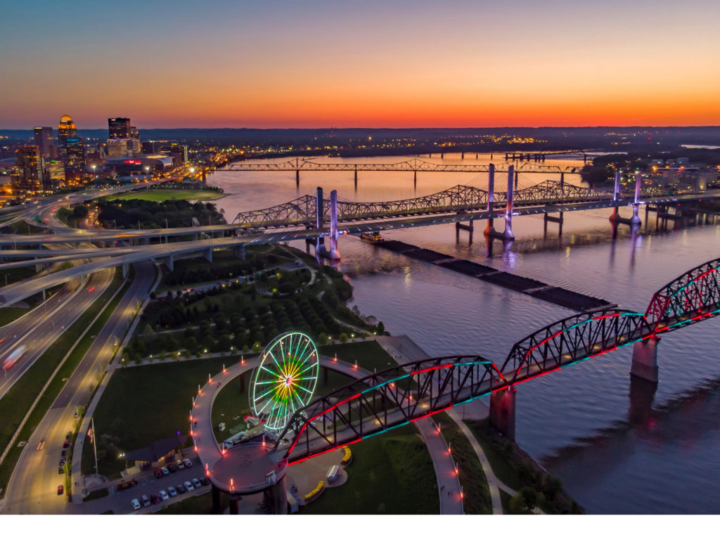 Photo of Louisville skyline and river at dusk